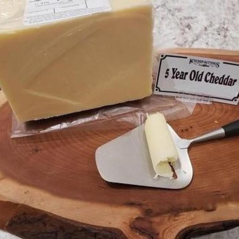 Fresh Cut 5 Year Old White Cheddar (per 1/2 lb.)